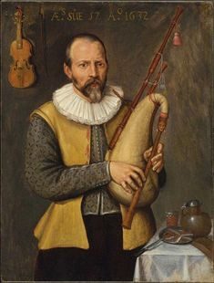 Bagpipe player with really nice doublet and ruff.