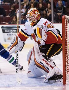 Goaltender Chad Johnson of the Calgary Flames plays against the Vancouver Canucks during their NHL game at Rogers Arena on October 15 2016 in...