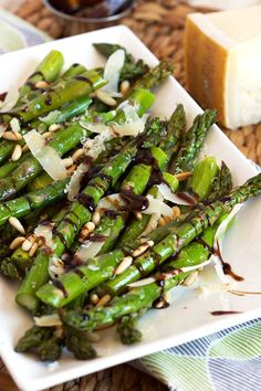 This amazing side dish recipe is ready in minutes. Roasted Asparagus with Pine Nuts, Parmesan and Balsamic Glaze is perfect for parties or an easy weeknight dinner. | @suburbansoapbox