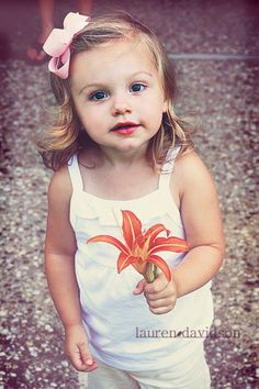 Female toddler vintage-style, hazy photo. Little girl with flower ideas.