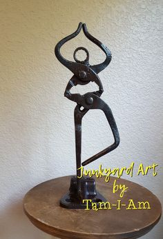 Junkyard Art by Tam-I-Am. Repurposed wrenches into yoga tree pose. Scrap metal art.