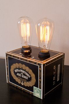 Double dimmable 60 watt Marconi bulbs on a traditional cigar box. The filaments make it a good ambient piece when it's dimmed, but it's also a great reading lamp! Cigar Box Projects, Cigar Box Crafts, Diy Projects, Cigar Box Art, Altered Cigar Boxes, Cigar Room, Palette, Cigars, Fun Crafts