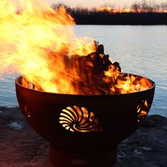 This Fire Pit Art® original Beachcomber design with Conch, Nautilus and Scallop sea shells is reminiscent of endless summer day's beachcombing for wonderful treasures of the sea. This gentle soothing