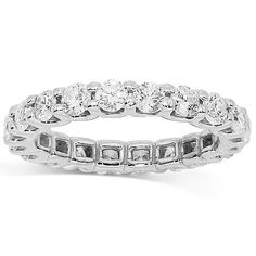 This lovely womens eternity band is crafted in 14K white gold. Brilliant round cut diamonds are prong set all the way around the band and total to 2.00 carats. The band measures to 3 mm in width and weighs 3.5 grams. $4,093.00
