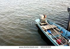 Canoe floating in water.