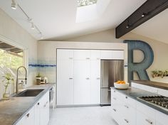 Houzz Tour: Bright Outlook for a Midcentury Home in the Trees  I LOVE those soapstone counters... a good option for our renovation.