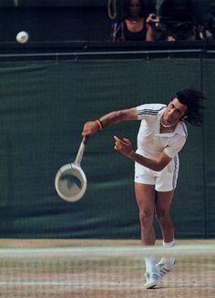 Ilie nastase hitting a serve at wimbledon.he's using an adidas racket as well as wearing the clothing line with the classic three Tennis Rules, Tennis Tips, Lawn Tennis, Dinner Recipes For Kids, Kids Meals, Tennis Techniques, How To Play Tennis, Tennis Serve, Tennis Legends