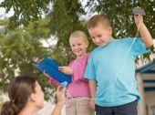 IE294-035 Children holding solar panels
