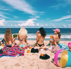 PHOTO INSPIRATION - friends hanging at the beach, (towels, beach balls, drinks) bikes to the sides combo of standing up and/or laying down