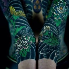 Japanese tattoo sleeves by @horitoshi1. #japaneseink #japanesetattoo #irezumi #tebori #colortattoo #colorfultattoo #cooltattoo #largetattoo #armtattoo #chesttattoo #tattoosleeve #flowertattoo #chrysanthemumtattoo #blackwork #blackink #blacktattoo #wavetattoo #naturetattoo