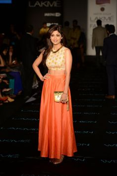 Shilpa Shetty looks chic in this crop top and tangerine skirt at Lakme fashion week.  #ShilpaShetty