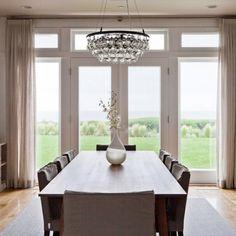 Trendy dining room photo with white walls and medium tone hardwood floors linen curtains designed @NatashaBarrault Design #diningroom #curtains#linencurtains #tancurtains