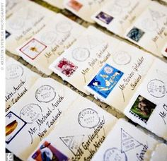 To complement their travel theme, Kiana and Brian decorated their escort cards with passport stamps and postal stamps from each featured country, which they had acquired during their worldly travels.