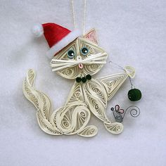 Santa's Helper Kitty Cat Hanging Ornament: Off White with Soft Blue Eyes and Red Santa's Hat. Hanging a Christmas Ornament with Gray Mouse.