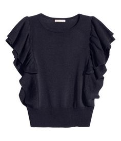 Fine-knit, slightly shorter top in a viscose blend with a sheen, with wide ribbing at the hem and wide, ribbed, frilled sleeves and a frill down the sides.