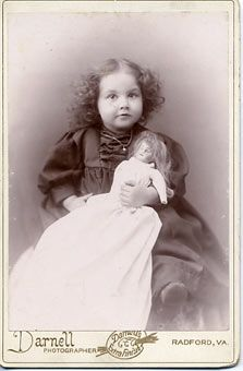 Old cabinet photo with the following notation on the back: Mary Edmonds, Taken March 1895, 2 and one half years old. With her bisque doll. So adorable!