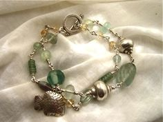 Handmade sterling silver wire work bracelet featuring .925 hill tribe silver charms. SOLD