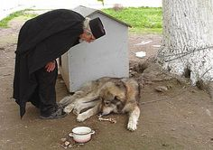 Orthodox Monk with his dog