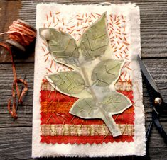 After you've eco-printed leaves on watercolor paper, stitch them into your art journal using simple embroidery stitches