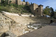 In the heart of old Málaga - Roman amphitheater in front and 10th century Moorish fort behind.