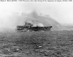 Battle of Leyte Gulf, October 1944. USS Princeton (CVL-23) burning, but still underway, about 20 minutes after she was hit by a Japanese air attack, 24 October 1944. Photographed from USS South Dakota (BB-57).