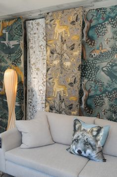 AW12 windows at Heal's featuring the Woodland trend. Zoffany Wallpapers and Fabrics used as a backdrop.