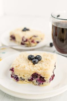 Blueberry Cream Cheese Coffee Cake has three layers to it. The cake layer on the bottom is sprinkled with blueberries and topped with a cream cheese filling. A crumb topping is sprinkled over the cream cheese filling to make 3 delicious layers. Lemon Blueberry Bundt Cake, Blueberry Recipes, Best Cake Recipes, Dessert Recipes, Desserts, Favorite Recipes, Amazing Recipes, Bread Recipes, Cream Cheese Coffee Cake