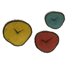 so unique - Three tree-inspired wall clocks. Product: Small, medium and large wall clockConstruction Material: PolyurethaneColor: Yellow, red and teal Accommodates: Batteries - not included Dimensions: Small: DiameterMedium: DiameterLarge: Diameter Red And Teal, Teal Yellow, Leather Wall, Cool Clocks, Rustic Home Design, Beyond The Rack, Crafty Craft, Crafty Projects, Wood Projects