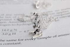 This tiny microscope necklace. | 19 Gifts Only Science Geeks Will Fully Appreciate