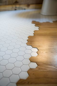 """-Tiny Hexagons leaking into the wood flooring """"Legacy"""" Tiny House on Wheels by Wood & Heart Co. Tiny Houses For Rent, Tiny House Listings, Tiny House On Wheels, Floor Design, Tile Design, House Design, Bathroom Flooring, Kitchen Flooring, Wood Flooring"""