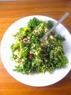 Kale, Quinoa and Cranberry Salad. The perfect Thanksgiving salad! The pumpkin seeds give this salad an amazing crunch!