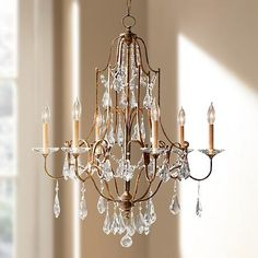 Elegance and sophistication define this chandelier finished in oxidized bronze and made of steel.