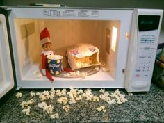 Elf on the Shelf Hosts Movie Night! Always a wonderful host, this Elf preps buttery popcorn for himself and friends.