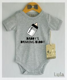 Funny baby boy clothes. Daddys drinking buddy baby romper. Baby boy cute clothes. --------------------------------------------------------------------------------------------- Fabric content: 100% cotton Professional grade super soft transfers which are perfect for the little ones. ---------------------------------------------------------------------------------------------- Care instructions: Turn garment inside out before washing in cold or warm water (30C / 65-85F). Machine wash cold…