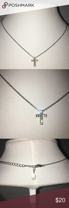 Simply Stated Cubic Zirconia Cross Necklace Classic Cubic Zirconia cross necklace to wear near your heart. Perfect to keep tucked into the shirt, or wear it tighter on top of collar bone boldly for the world to see. Jewels shine brightly in the daylight. Jewelry Necklaces