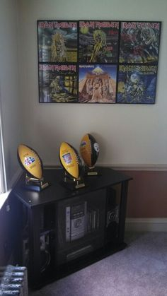 Remastered Iron Maiden vinyl albums framed with my 6 time Steelers collectible footballs.