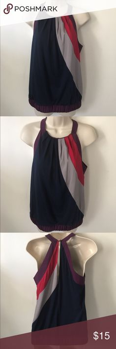 Color Block Tank Top from hype Super cute tank top with keyhole back from hype. Paneling of blue, gray, and pink with purple straps and waist band. Waist band has elastic for stretch. 60% Polyester, 34% Rayon, 6% Spandex. Great condition! Hype Tops Tank Tops