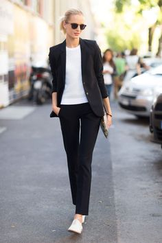 Daria Strokous in black suit and white shirt with white brogues - as Balenciaga once said: 'the secret for elegance is removing'