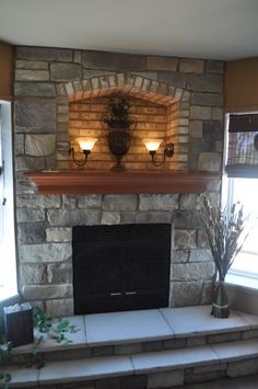 Stoned Fireplace with Cove, 2-step Hearth, and Crown Maple Mantle with Extended Shelf. Bucks Creek Cut Cobble and Desert Tan Brick J&N Stone