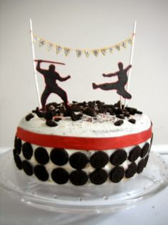Ninja Cake - with mini ninjas and a big 6 candle instead of the banner and cake toppers. Probably no crushed cookie on top either