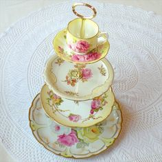"vintage wedding cake/dessert stands Love them!  These are custom made, but I bet I could make one...hey mom, you wanna ""loan"" me some of your teacup collection? :D"