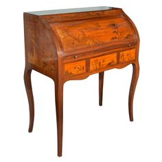 French Art Nouveau marquetry cylinder roll desk with pull out writing surface, four fitted drawers and three in the case.