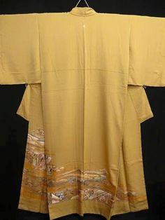 A kimono with a heian era design along the bottom.