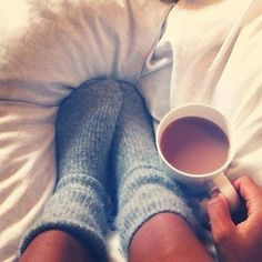 Cozy morning with fuzzy socks and coffee