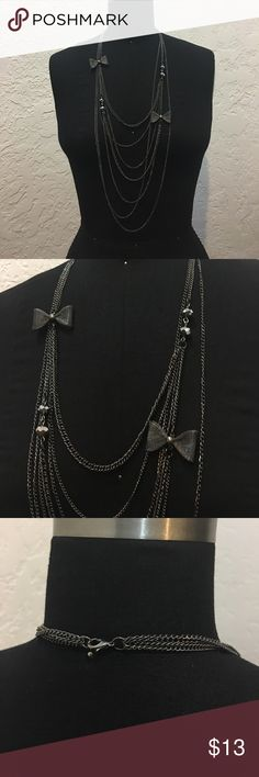 Layered Chain Necklace Black metal layered necklace with metal bows and black rondelle beads. Jewelry Necklaces