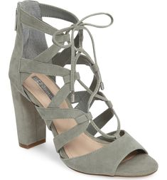 Ghillie-style lacing ladders up the front of this gladiator-inspired cage sandal lifted by a slender, wrapped stiletto.