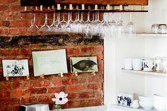 kitchen - brickwork and displayed glassware
