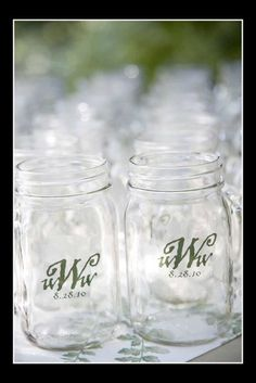 best.wedding.favor.ever.  mason jar with handles - branded with a sticker.  don't forget the lid.