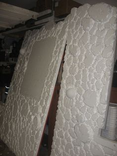 Styrofoam Faux Stone Wall... this is pretty neat idea!!!