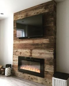 Diy Tv Stand With Electric Fireplace.Inspirations: Electric Fireplace Tv Stand Lowes For . Fireplace Accent Walls, Fireplace Tv Wall, Fireplace Design, Wall Tv, Pallet Fireplace, Fireplace Ideas, Fireplace Modern, Master Bedroom Wood Wall, Electric Fireplace Surround